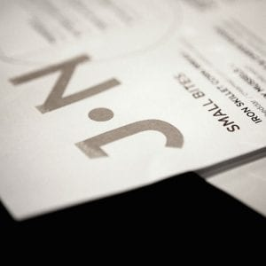 close up of logo on J Nichols menu