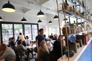 Bright interior photo of people dinning in the Atlantic restaurant