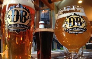 closeup shot of full beers in two glasses with Devils Backbone Brewing Company logo