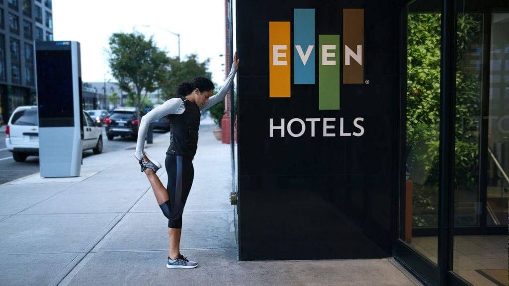 Woman stretching her legs in front of Even Hotels