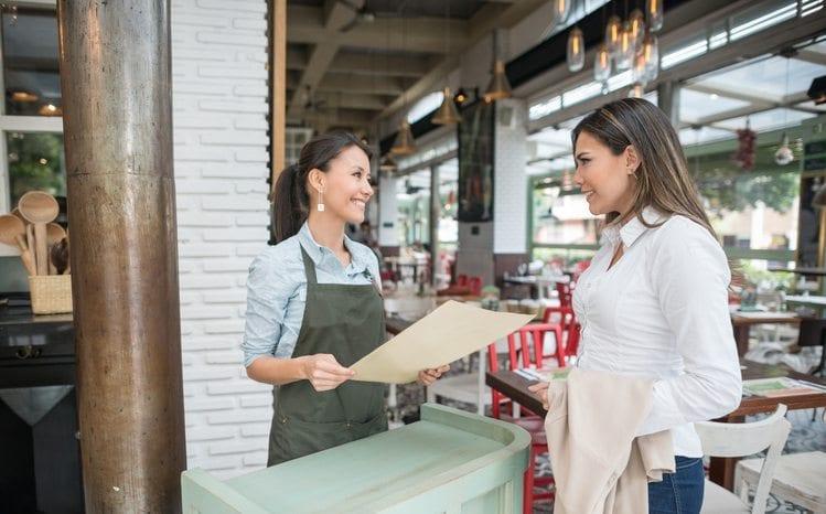 hostess helping a guest