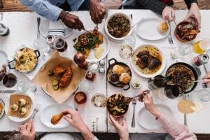 aerial view of friends sharing plates of food at JCT Kitchen