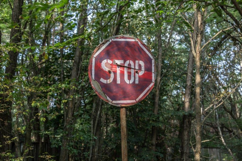 battered stop sign