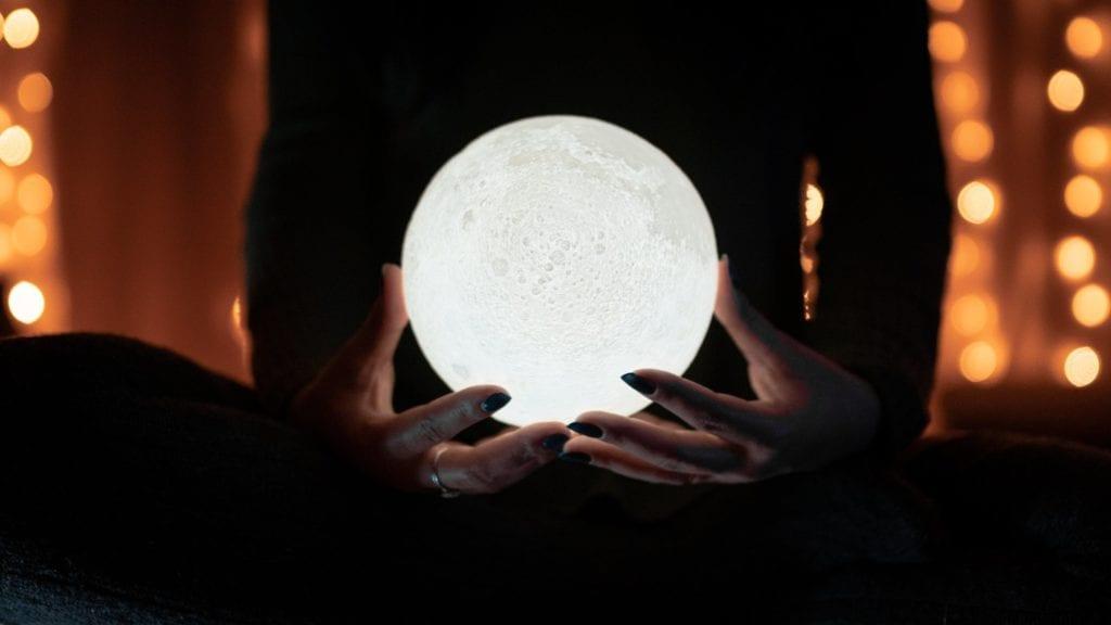woman holding moon ball