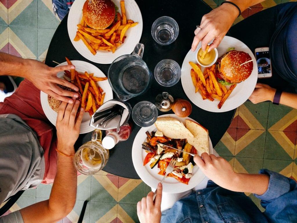 aerial view of people eating burgers