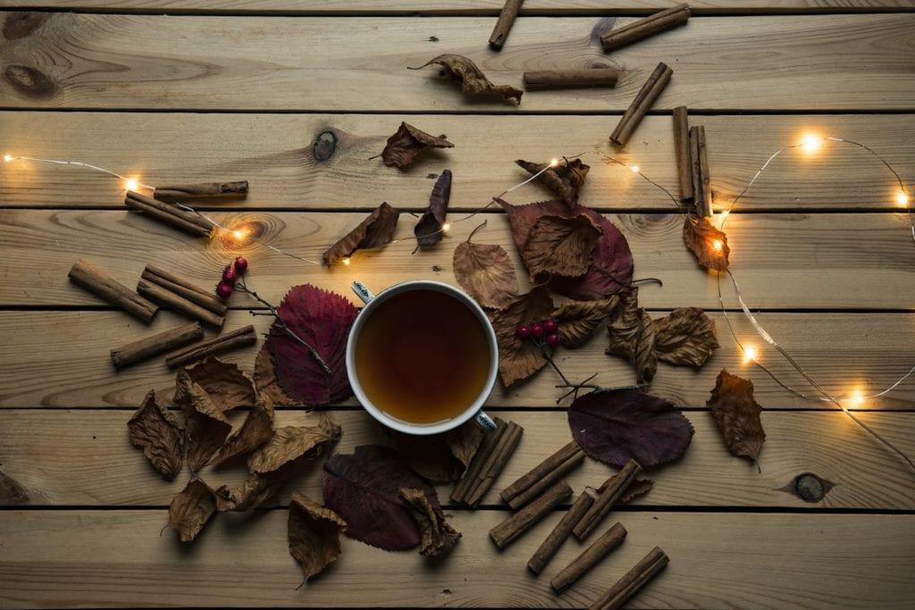 hot tea over bed of fall leaves